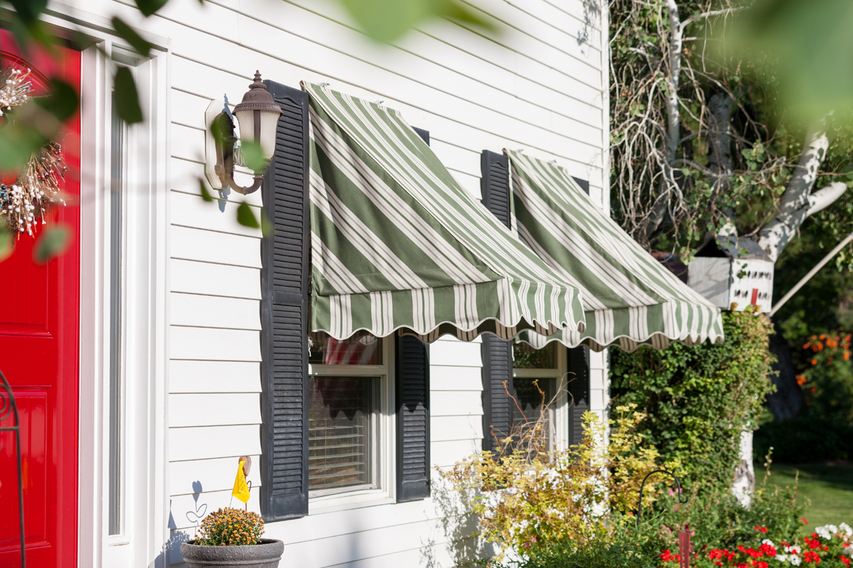 magazine for awnings design house arts striped an blue appeal featured lend awning of archival practical to the summery window a in exteriors